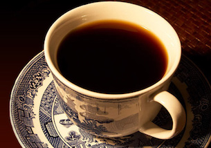Black cup of coffee in porcelain cup.